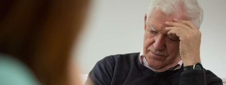 psychiatrist helping an older man